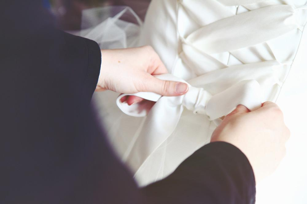 Tying a wedding dress