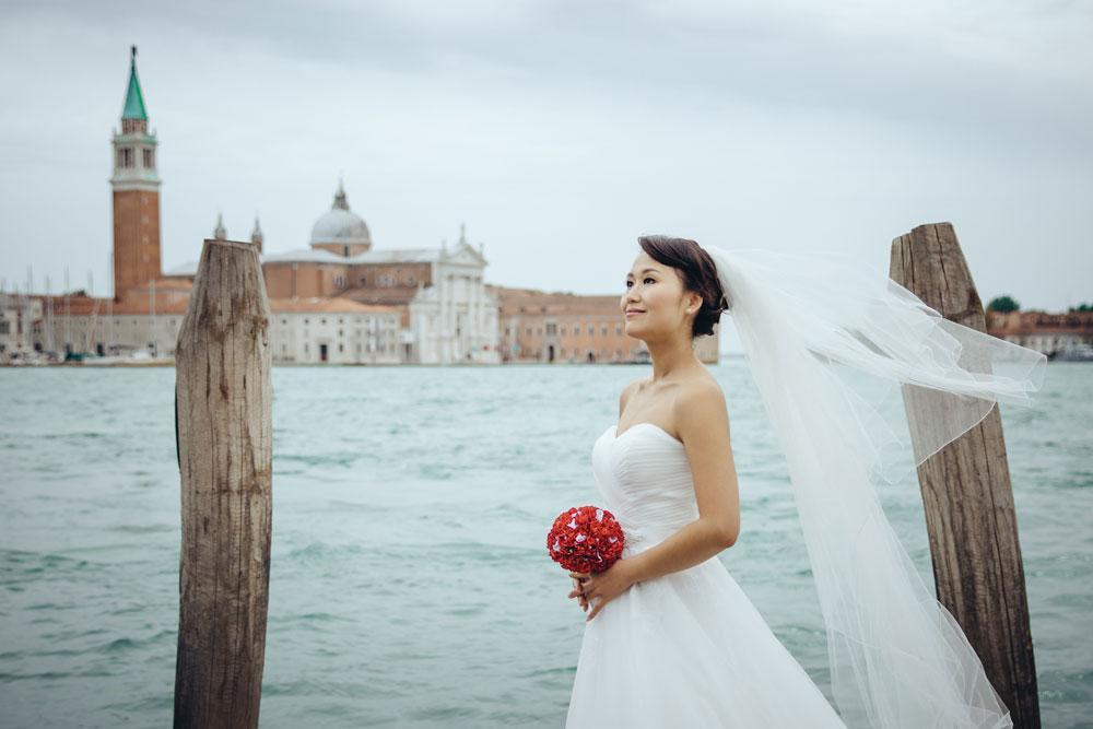 Bride posing on a deck in Venice