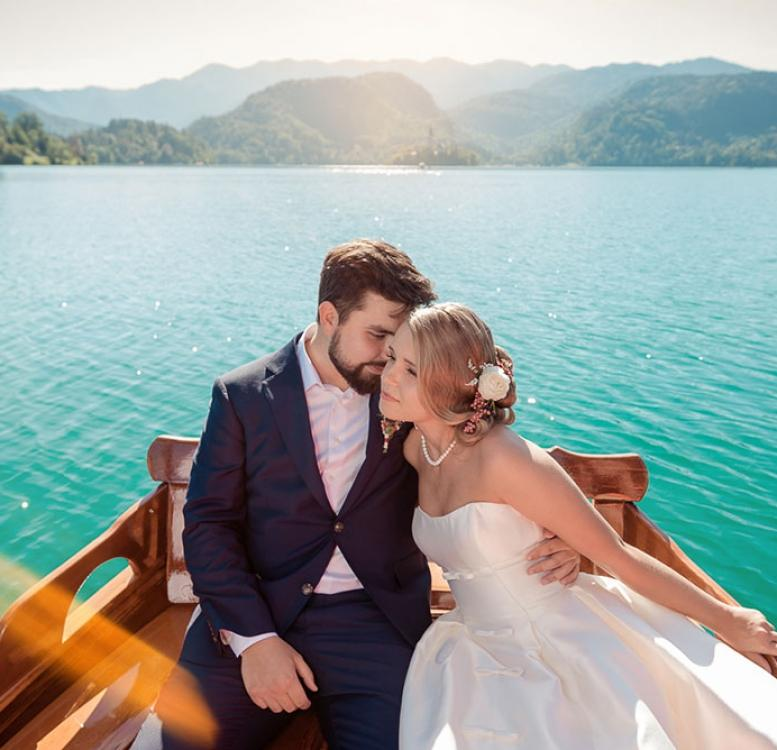 Newlyweds on a boat to Bled Island