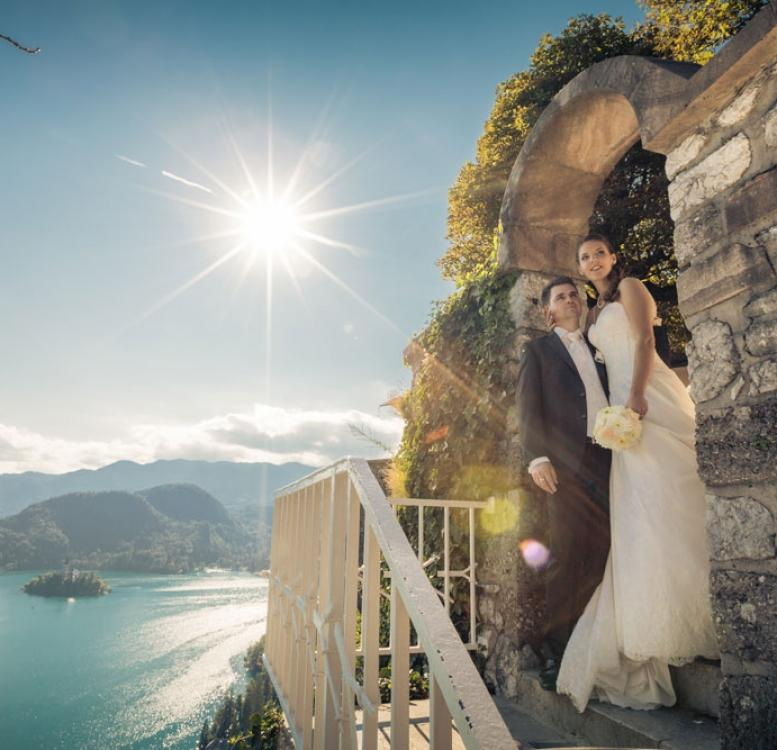 Couple on the stairs with Bled Island in the background