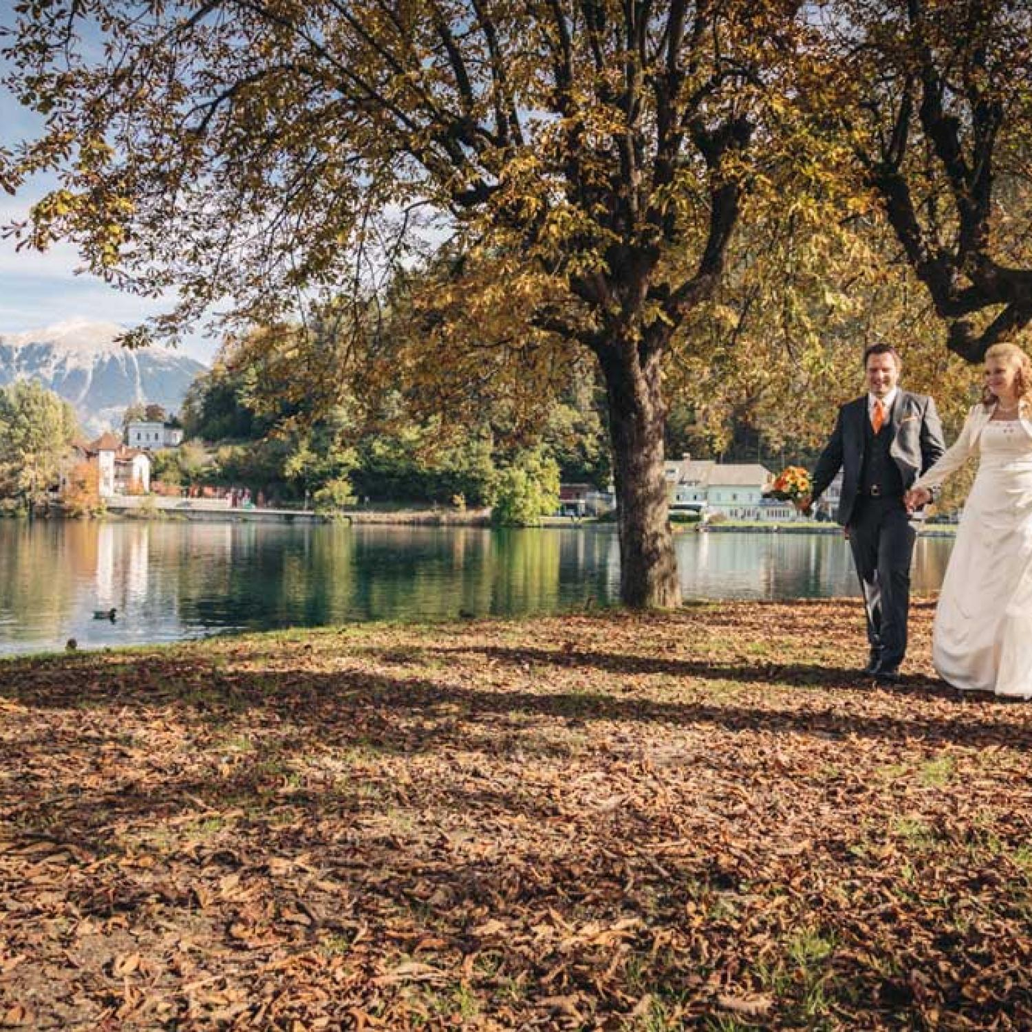 Couple next to Bled Lake in autumn