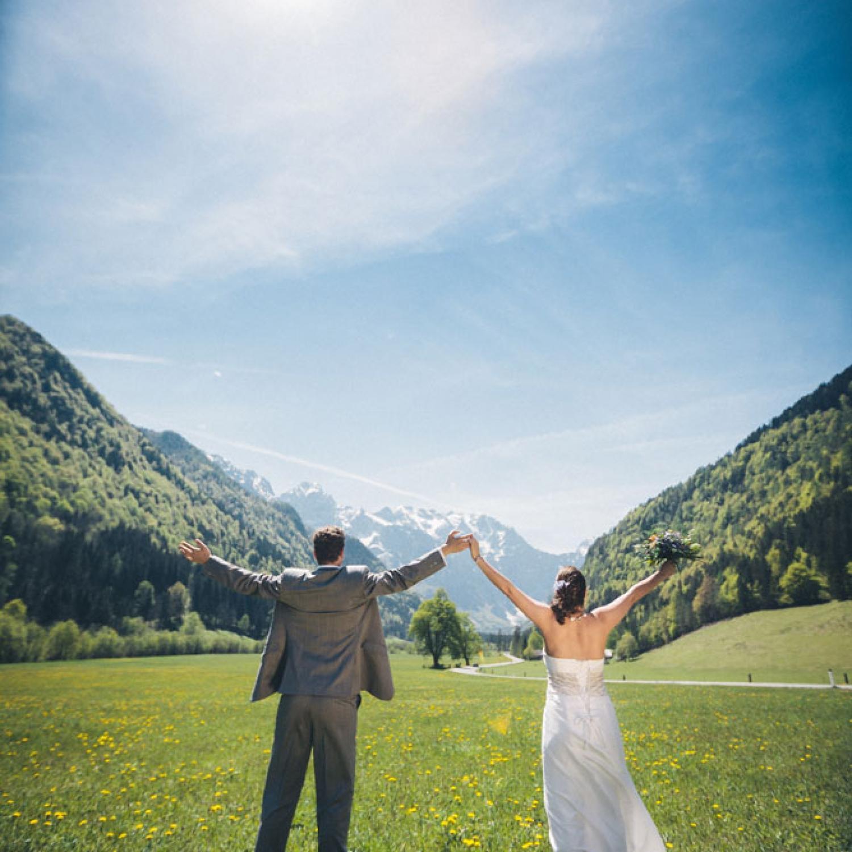 Newlywed couple greeting the sunshine
