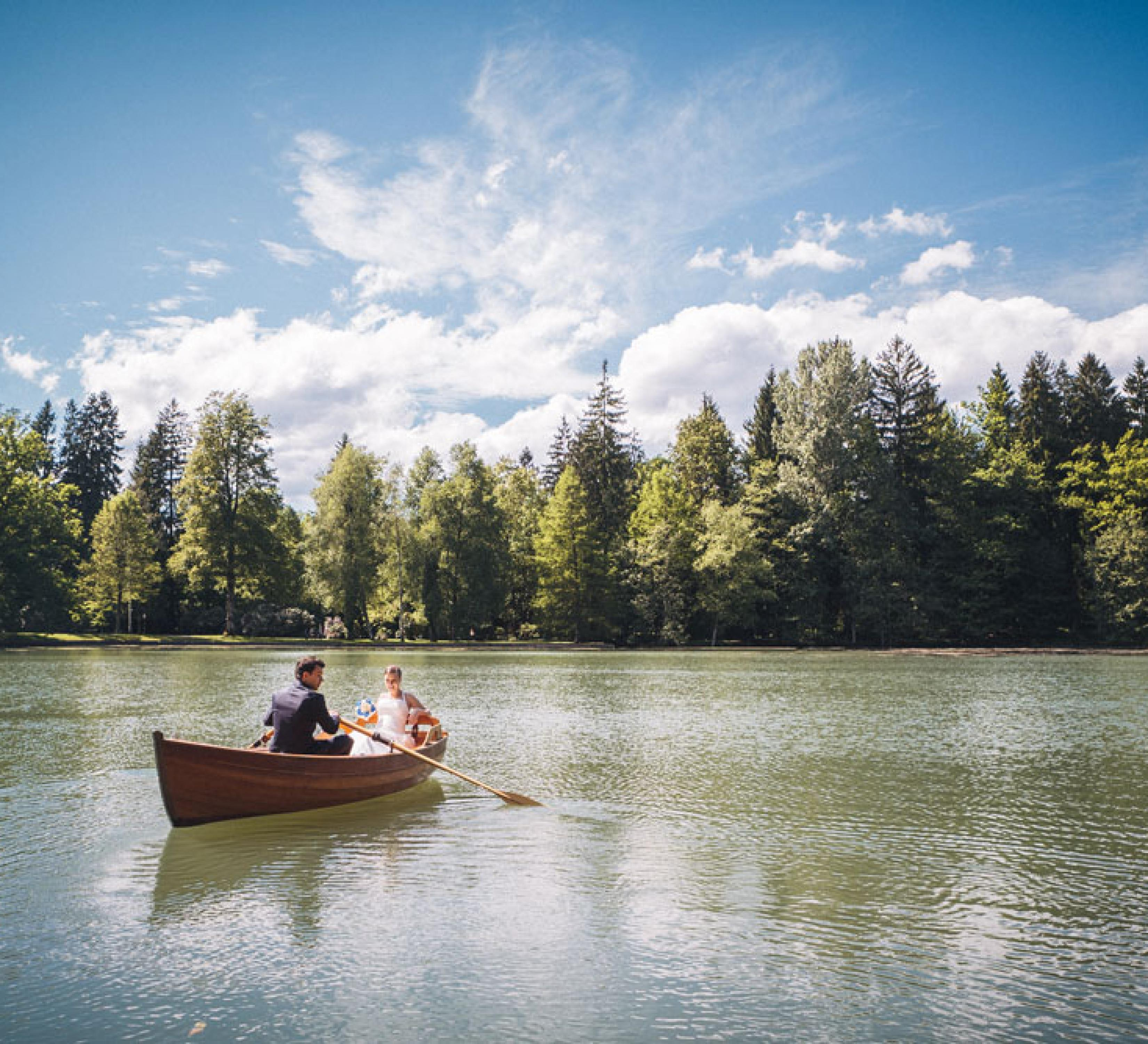 Couple on a wooden rowing boat in Brdo