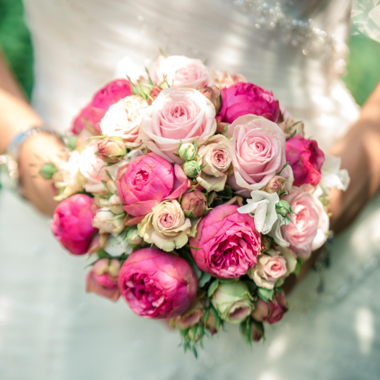Bride holding a pink wedding bouquet
