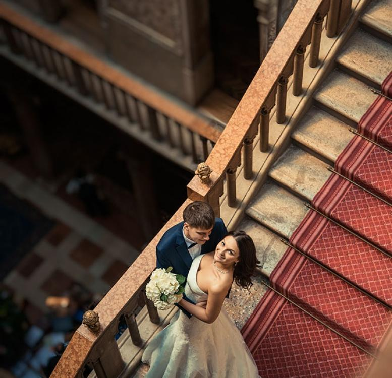 Couple posing on the stairs