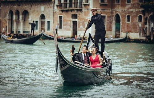 Couple on gondola in Venice