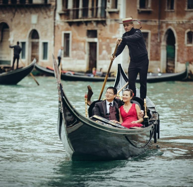 Couple on gondola in Venice