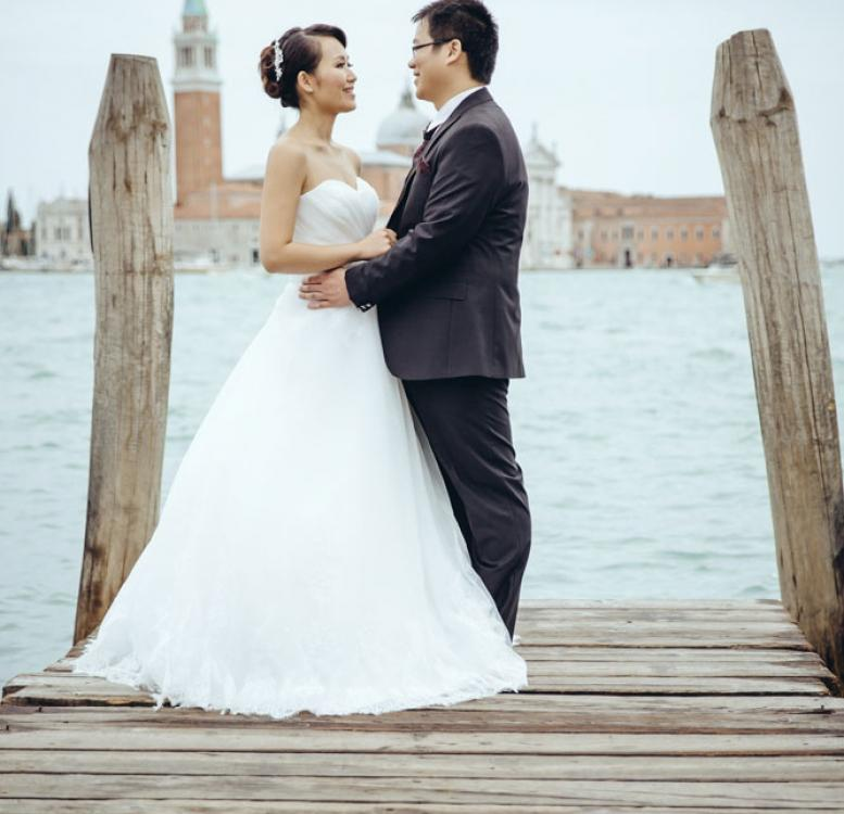 Newlyweds posing on a deck in Venice