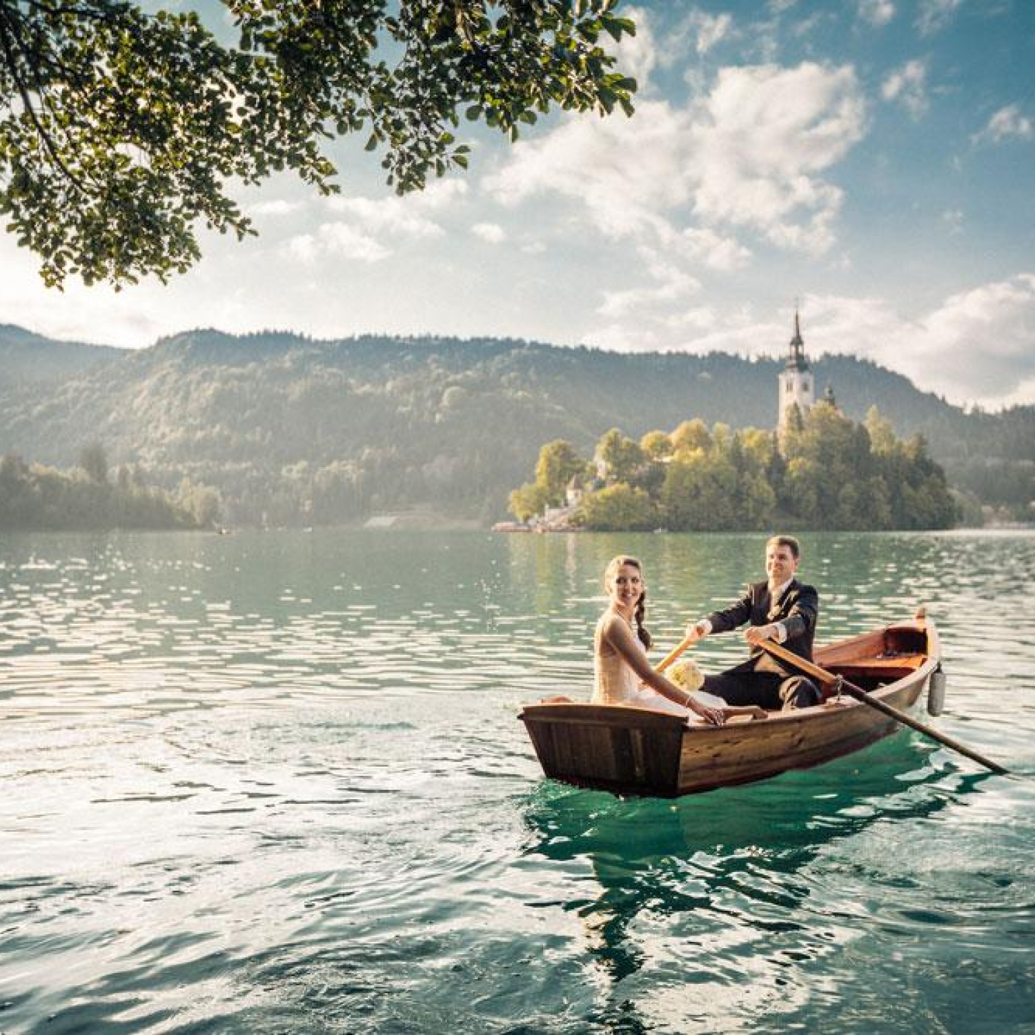 Couple on a wooden rowing boat on Lake Bled
