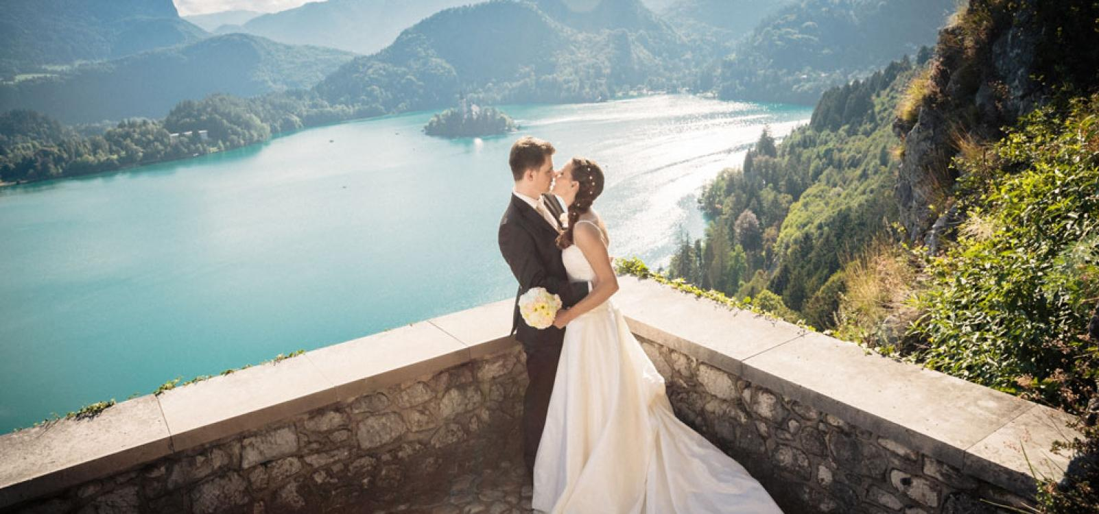 Couple on a Bled Castle terrace with Bled Island at the background