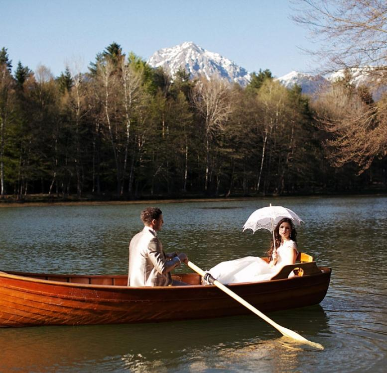 Couple on the wooden boat in Brdo