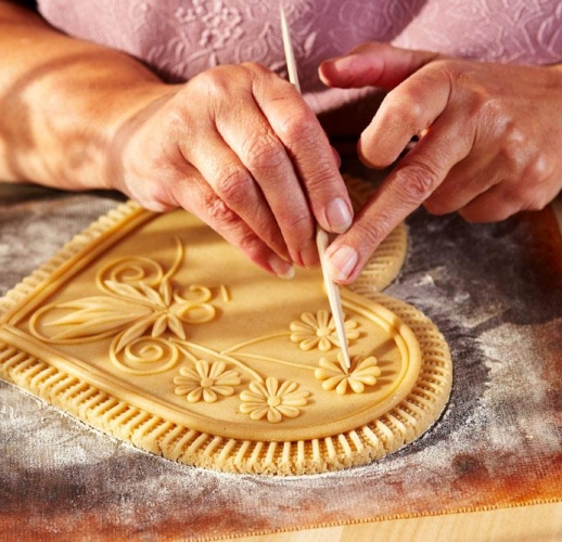 Slovenia - A woman making Drazgose honey bread