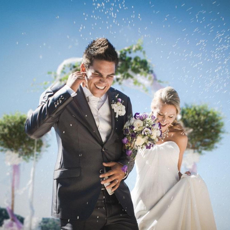 Rice falling on newlywed couple